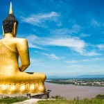 The Golden Buddha at Phu salao temple overlooking the Mekong river and the city of Pakse, Laos.